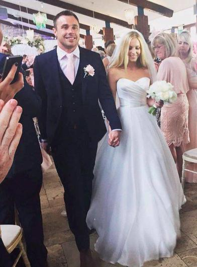 Tommy Bowe walking down the aisle with his wife Lucy Whitehouse