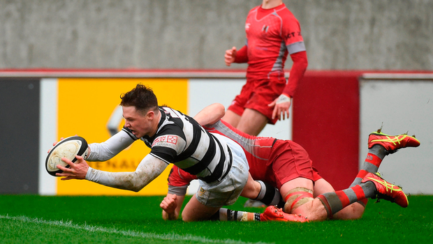 Peter Sylvester of PBC scores his side's first try despite the efforts of Rory Clarke of Glenstal Abbey. Photo: Sportsfile