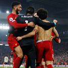 Liverpool's Mohamed Salah celebrates scoring their second goal with team-mates