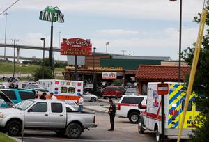 Bikers wait in a line as law enforcement officers investigate the parking lot near a Twin Peaks restaurant Sunday, May 17, 2015, in Waco, Texas.(Rod Aydelotte/Waco Tribune-Herald via AP)