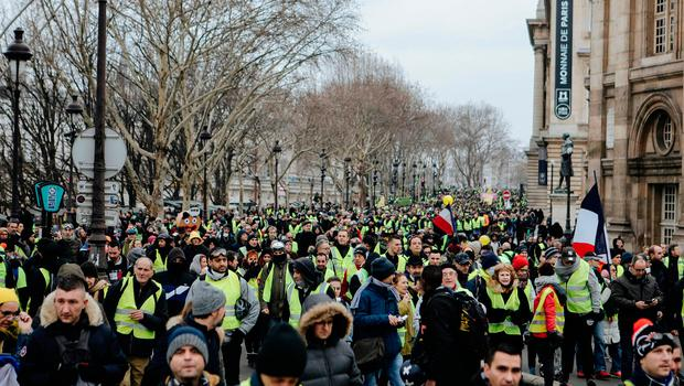 Demonstrators wearing yellow vests march during a protest in Paris, Saturday, Jan. 5, 2019. Hundreds of protesters were trying to breathe new life into France's apparently waning yellow vest movement with marches in Paris and gatherings in other cities. (AP Photo/Kamil Zihnioglu)