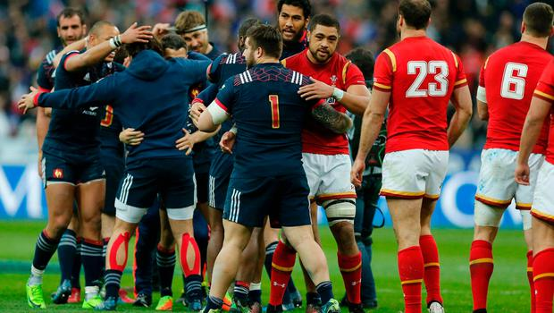 France's players celebrate after beating Wales