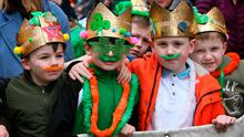 From left: Mason Meehan, Rhys Creen, Luke Lawless and Troy Kelly (all 7) from St Laurence O'Toole National Boys School at the parade in Dublin yesterday. Photo: Mark Stedman