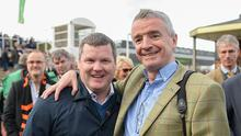 Trainer Gordon Elliott, left, with owner Michael O'Leary after winning the OLBG Mares' Hurdle with Apple's Jade during the Cheltenham Racing Festival