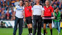 Tipperary manager Eamon O'Shea and Kilkenny boss Brian Cody look up at the big screen along with the sideline officials as Hawkeye rules on John O'Dwyer's late free. Photo: Pat Murphy / SPORTSFILE