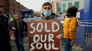 Chelsea fans protest outside Stamford Bridge stadium in London, against Chelsea's decision to be included amongst the clubs attempting to form a new European Super League. (AP Photo/Matt Dunham)