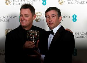 Jeff Pope, left, and Steve Coogan celebrate winning Best Adapted Screenplay for Philomena at the BAFTA awards ceremony. Photo: Reuters/Suzanne Plunkett