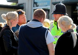 Volunteers from the local community gather near to the home of missing teenager Amber Peat in Mansfield as police organise people into small groups to search the local area. Chris Radburn/PA Wire