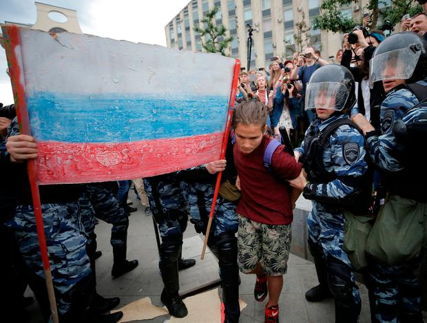 Riot police detain a demonstrator during an anti-corruption protest organised by opposition leader Alexei Navalny, on Tverskaya Street in central Moscow, Russia June 12, 2017. REUTERS/Maxim Shemetov