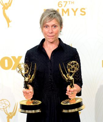 Actress Frances McDormand, winner of the award for Outstanding Lead Actress in a Limited Series or Movie for 'Olive Kitteridge' and the award for Outstanding Limited Series for 'Olive Kitteridge', poses in the press room at the 67th Annual  Primetime Emmy Awards at Microsoft Theater on September 20, 2015 in Los Angeles, California. (Photo by Kevork Djansezian/Getty Images)