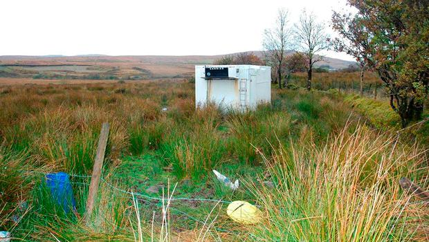 Squalid shipping container where kidnapped cattle dealer Paul Gogan was held hostage Credit: PSNI/PA Wire