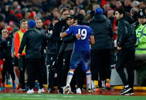 Chelsea manager Antonio Conte hugs Diego Costa after the game