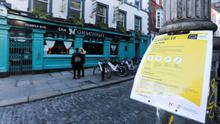 Virus: A notice about coronavirus hung on a lamppost in Temple Bar yesterday. Photo: REUTERS/Lorraine O'Sullivan