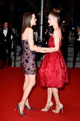 """Marion Cotillard and Madeline Mulqueen depart the """"Macbeth"""" Premiere during the 68th annual Cannes Film Festival on May 23, 2015 in Cannes, France.  (Photo by Pascal Le Segretain/Getty Images)"""