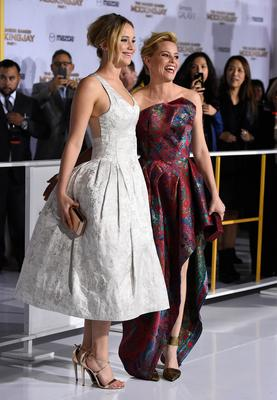 "Actresses Jennifer Lawrence (L) and Elizabeth Banks attend the premiere of Lionsgate's ""The Hunger Games: Mockingjay - Part 1"" at Nokia Theatre L.A. Live on November 17, 2014 in Los Angeles, California.  (Photo by Frazer Harrison/Getty Images)"
