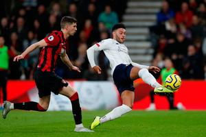 Liverpool's English midfielder Alex Oxlade-Chamberlain (R) strikes the ball to score the opening goal ahead of Bournemouth's Welsh defender Chris Mepham (L) during the English Premier League football match between Bournemouth and Liverpool at the Vitality Stadium in Bournemouth, southern England on December 7, 2019. (Photo by Adrian DENNIS / AFP)