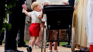 July 2015: Britain's Prince George arrives for the christening of his sister Princess Charlotte at the Church of St Mary Magdalene on the Sandringham Estate in King's Lynn, July 5, 2015  REUTERS/Chris Jackson/Pool