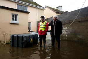 Sean Kiely, Saint Muchins Street (right) showing Limerick City Council's Kieran Lehane the flood damage at his home after the floods in Limerick earlier this month. Picture: Sean Curtin Photo.