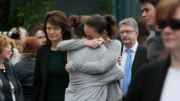 Students console each other at a service for the victims of the Berkeley tragedy in UCD yesterday