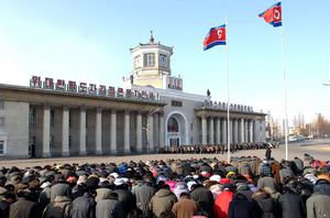 People offering silent prayers in front of the Pyongyang station on the first anniversary of leader Kim Jong-Il's death, December 2012.