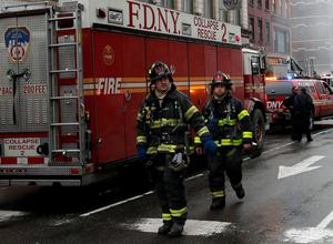 New York City Fire Department firefighters walk away from the site where a residential apartment building collapsed and was engulfed in flames in New York City's East Village neighborhood. Reuters/Mike Segar