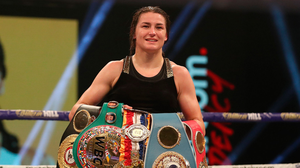 Katie Taylor shows off her belts after her victory against Miriam Gutierrez at the SSE Wembley Arena in London. Photo: Mark Robinson / Matchroom Boxing via Sportsfile