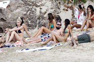 Leonardo Di Caprio was spotted shopping and partying with a mystery blond woman, pictured in the black bikini