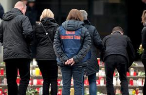 Relatives of students and a member of Special Assistance Team stand in front of the Joseph-Koenig-Gymnasium high school in Haltern am See, March, 25, 2015. REUTERS/Ina Fassbender
