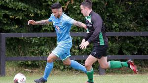 Romash Badhan of North End United B is chased by Oran Maddock of Crossabeg AFC during their Tier 1 Group G match on Sunday.