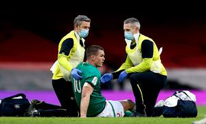 Jonathan Sexton of Ireland is attended to by team physio Keith Fox, left, and team doctor Dr Ciaran Cosgrave
