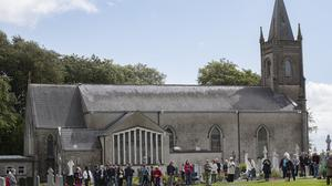 Fr Thomas O'Mahony celebrates outdoor mass with his congregation at St Colmcilles church in Skryne, Co Meath. Picture: Arthur Carron