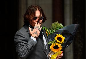 Libel action: Johnny Depp arrives at the Royal Courts of Justice in London, England, yesterday. Photo: Stuart C. Wilson/Getty Images