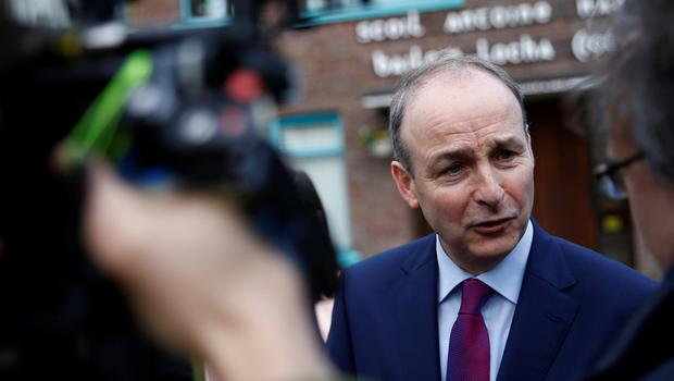 Fianna Fail leader Micheal Martin addresses the media after casting his vote in Ireland's national election in Cork, Ireland, February 8, 2020. REUTERS/Henry Nicholls