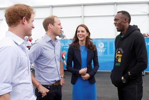 Prince Harry (L), Prince William (2nd L) and Catherine, Duchess of Cambridge (C) speak to Jamaica's Usain Bolt during a visit to the Commonwealth Games Village in Glasgow. Reuters