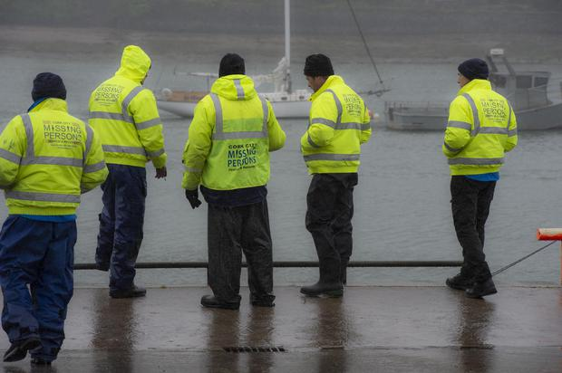 Volunteers look on as Garda divers conduct an operation at the scene. Photo: Provision