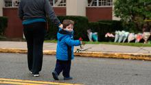 Sadness: A boy brings a flower to the memorial at the Tree of Life synagogue in Pittsburgh. Photo: REUTERS/Cathal McNaughton