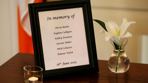 A list of the names of the victims beside a book of condolence at Mansion House in Dublin opened in memory of those killed in the Berkeley balcony collapse. Niall Carson/PA Wire