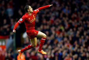 Liverpool's Jordan Henderson celebrates his goal against Swansea
