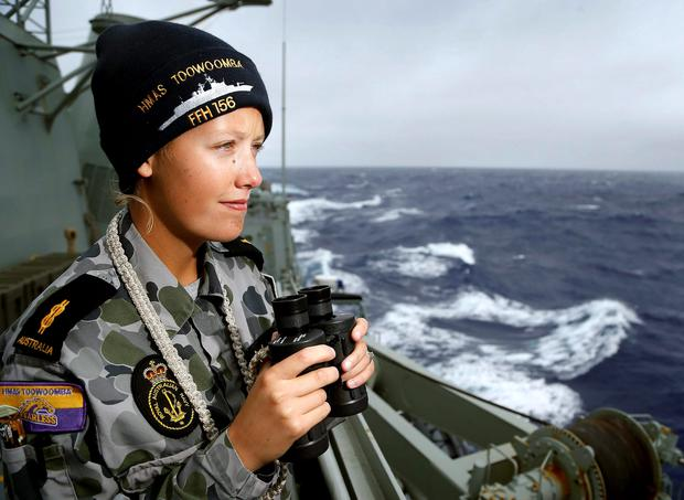 Able Seaman Boatswains Mate Stephanie Went keeps watch for any sign of debris aboard the Australian Navy ship HMAS Toowoomba as it continues the search in the southern Indian Ocean for the missing Malaysian Airlines flight MH370