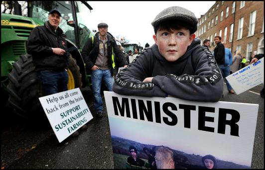 Padraig McCaul (13) from Canningstown Cavan whose father Seamus is a Beef farmer protesting on Merrion Square. Pic Steve Humphreys