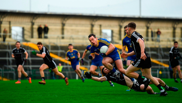 Donie Smith of Roscommon in action against John Francis Carr of Sligo. Photo by David Fitzgerald/Sportsfile