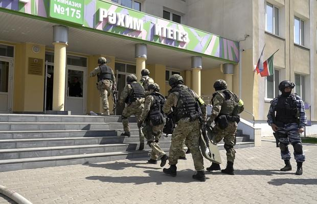 A Russian police special unit near the scene in Kazan (The Investigative Committee of the Russian Federation via AP)
