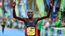 27 October 2014; Eliud Too, Kenya, celebrates winning the SSE Airtricity Dublin Marathon 2014 in a time of 2:14:48. Merrion Square, Dublin. Picture credit: Ramsey Cardy / SPORTSFILE