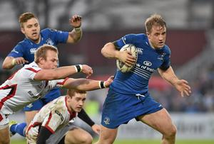 Leinster's Luke Fitzgerald gets away from Ulster duo Paul Marshall and Paddy Jackson during their Guinness Pro12 clash at the RDS. Photo: SPORTSFILE