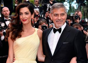 "Lawyer Amal Clooney (L) and actor George Clooney attend a screening of ""Money Monster"" at the annual 69th Cannes Film Festival at Palais des Festivals on May 12, 2016 in Cannes, France.  (Photo by Pascal Le Segretain/Getty Images)"