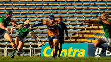 Thrill of the chase: Limerick trio William O'Donoghue, Diarmaid Byrnes and Dan Morrissey try to stop Clare's Shane O'Donnell. Photo: Sportsfile