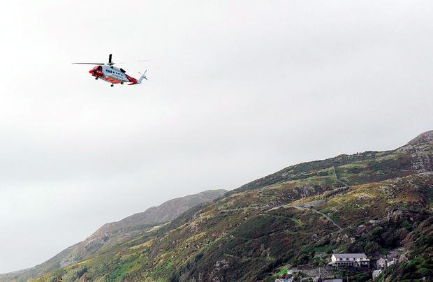 A rescue helicopter searches over Barmouth as two boys and a man are missing in the sea off the Welsh coast in separate incidents