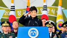 South Korean President Park Geun-hye salutes during a joint commissioning ceremony for 5,860 new officers from the Army, Navy, Air Force and Marines at the military headquarters in Gyeryong, south of Seoul March 6, 2014. REUTERS/Jung Yeon-je/Pool (SOUTH KOREA - Tags: MILITARY POLITICS TPX IMAGES OF THE DAY)