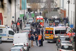 Ambulances gather in the street outside the French satirical newspaper Charlie Hebdo's office, in Paris. (AP Photo/Francois Mori)