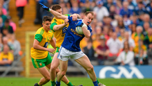 Martin Reilly of Cavan is tackled by Eoghan Bán Gallagher of Donegal